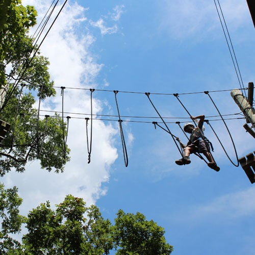 A  young man on High rope course